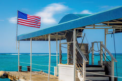 Lone jetty flying American flag stock photo