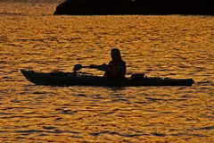 Lone kayak. Er at sunset Stock Photography