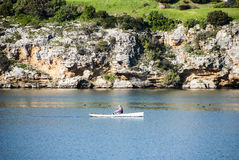 Lone Kayaker. A lone kayaker paddling down a river Royalty Free Stock Images