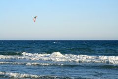 Lone kite-surfer at the sea stock photo
