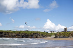 Lone kite surfer surfing at ballybunion beach. Lone kite surfer surfing the waves at ballybunion beach on the wild atlantic way Stock Photo