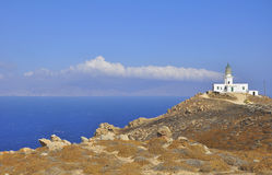 Lone lighthouse on the hillside near the sea Stock Photography