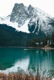 A lone little canoe makes it way across Emerald Lake in Yoho National Park. Of BC Royalty Free Stock Photo