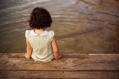 Little child on pier Stock Photo
