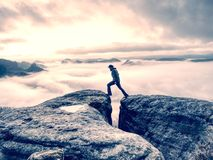 Free Lone Male Hiker Looks Out Over High Mountains And Valley Stock Image - 164791431