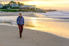 Lone man on beach at sunrise Royalty Free Stock Photography