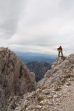Lone man in The Dolomites,Italy. Man surveys view,Dolomites,Italy Stock Photos