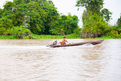 Lone man in dugout on Mekong. Royalty Free Stock Photography