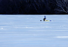 Lone man ice-fishing Royalty Free Stock Photo