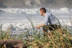 Lone man at USA Pacific coast beach Stock Photo