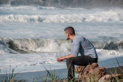 Lone man at USA Pacific coast beach Royalty Free Stock Photos