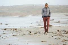 Lone man at USA Pacific coast beach Royalty Free Stock Photo