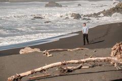 Lone man at USA Pacific coast beach Royalty Free Stock Photography
