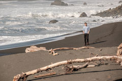Lone man at USA Pacific coast beach Royalty Free Stock Image