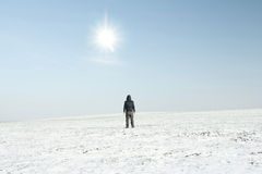 Lone man in winter fields Stock Photography