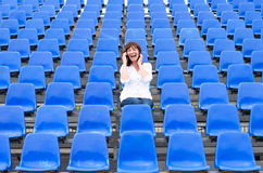 Lone middle-aged woman in a stadium stock photo