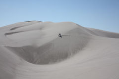 Lone motorcycle rider at St Anthony sand dunes in Idaho Stock Photography