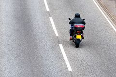 Lone motorcycle on uk motorway in fast motion.  royalty free stock photography