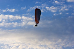 Lone paraglider. Clear blue sky with white clouds and lone paraglider Stock Photography