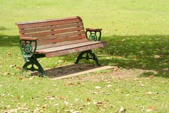 Lone park bench. Lone cast iron and timber park bench Royalty Free Stock Photo