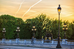 Lone passerby on Alexander III bridge at dawn Royalty Free Stock Photography