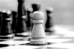 Lone pawn against opponents Royalty Free Stock Photography