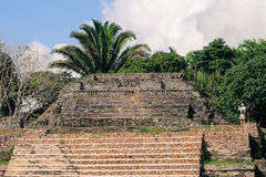 Photographer Belize Ruins Travel. A single photographer and tourist on the ruins in Belize royalty free stock photos