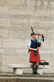 A lone Piper on the river bank, Paris Stock Images