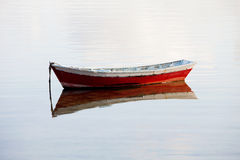 Lone red boat floating Royalty Free Stock Images