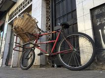 Lone Red Delivery Bicycle Royalty Free Stock Image