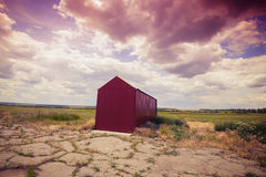 Lone red hangar on the abandoned airfield Royalty Free Stock Photo