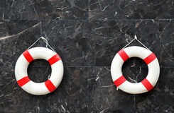 Lone red life ring, on the wall beside pool Stock Image