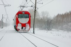 A lone red locomotive hurtling through blizzard Stock Images