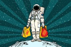 Lone retro astronaut with a sale shopping bags. Pop art retro vector illustration Royalty Free Stock Image
