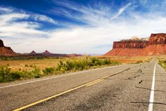 Lone rider in canyonlands. Open road wih a lone biker, Canyonlands national park, Utah Royalty Free Stock Photo
