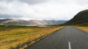 Lone Road. In Iceland disappearing into the mountains Royalty Free Stock Photo