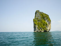 Lone Rock. Sits in the middle of the open water of Krabi Thailand Stock Images