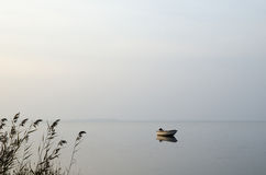 Lone rowing boat in calm water Royalty Free Stock Images