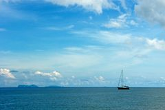 A lone sail boat in the blue sea Royalty Free Stock Images