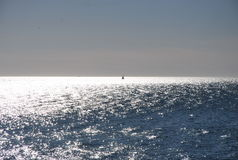 A Lone Sail Boat in the Sea Royalty Free Stock Images
