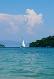 Lone sailboat Stock Images