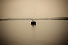 Lone sailboat Stock Photography