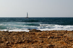 A lone sailboat Stock Photography