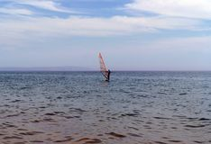 a lone sailboat, sliding on the smooth surface of the black sea in Arkhipo-Osipovka. stock image