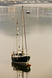 Lone sailboat vessel moored in the harbor Royalty Free Stock Photography