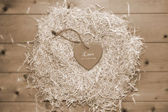 Lone sepia heart in a love nest Stock Photo