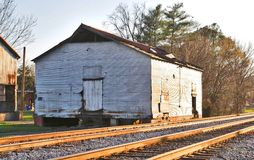 Shanty in The Railyard. A shack sits beside the railroad tracks, it may have served as makeshift housing for railroad workers long ago Stock Photo
