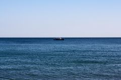 A lone ship on the sea horizon.  royalty free stock images