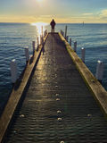 Lone silhouette at the jetty. At sunset royalty free stock photo