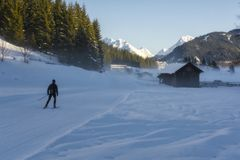 Lone skier heading for the mountains stock photo